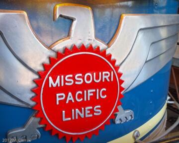 """Mopac """"Buzzsaw"""" on tail of Missouri Pacific Eagle Parlor – Observation Lounge #750"""