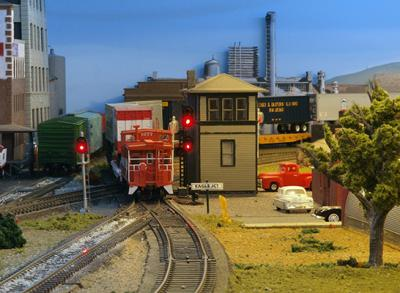 Caboose #1272 passes Eagle Tower at Eagle Jct.